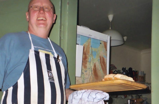 Our chef, bearing fresh-baked bread