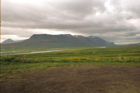 Iceland under a threatening sky. Is that a glacier in the distance?